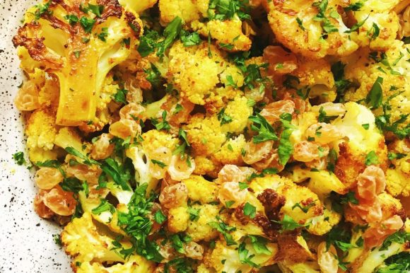 Curry Turmeric Roasted Cauliflower with Golden Raisins and Parsley