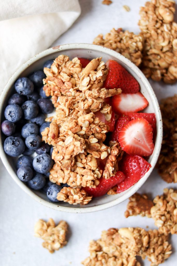 peanut butter granola, berries and yogurt bowl