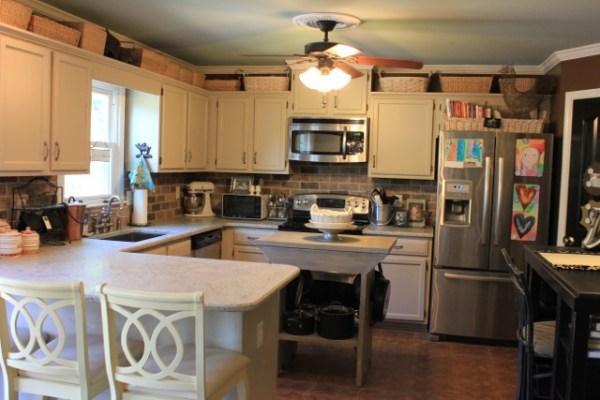 over kitchen cabinet storage My Kitchen - daisymaebelle | daisymaebelle