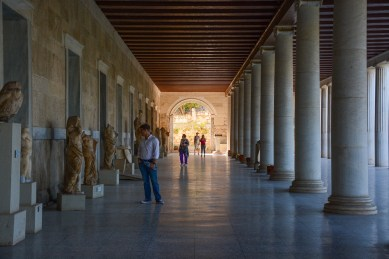 Perusing the various artifacts on display in the Stoa of Attalos
