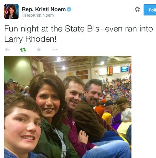 Rep. Kristi Noem, husband Bryon, and Larry Rhoden at Boys State B Basketball tournament, Aberdeen, SD, 2015.02.21. Posted to Twitter by Rep. Noem.