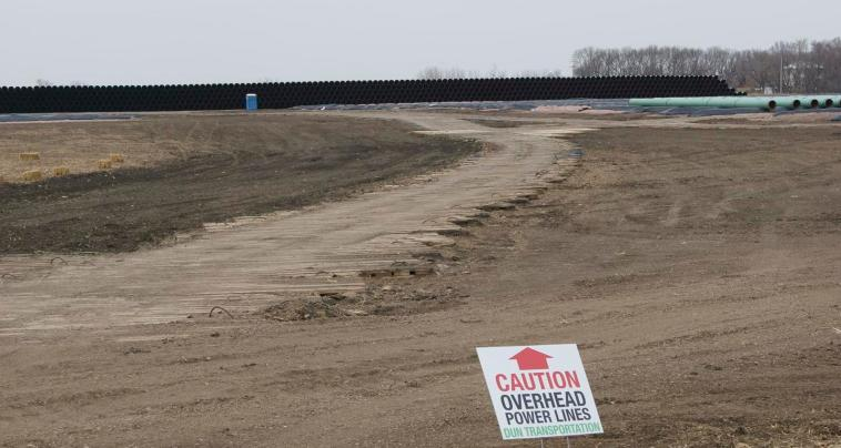 Plank road leading to pipe stockpile. Schriever says plank roads and berms have been set up for three or four more rows of pipe.