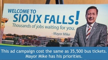 Sioux Falls Mayor Mike Huether would rather pay for big ads with his face on them than bus tickets for kids.