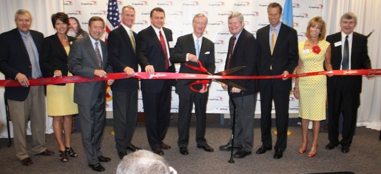 Capital One Sioux Falls ribbon cutting: (L to R) Slater Barr, U.S. Rep. Kristi Noem, Mayor Mike Huether, Gov. Dennis Daugaard, Curt Milroy (VP, Operations), Dan Mortensen (SVP, corporate real estate & HR operations), U.S. Sen. Tim Johnson, U.S. Sen. John Thune, Barb Stork and Evan Nolte. Photo from Sioux Falls Area Chamber of Commerce, May 2012.