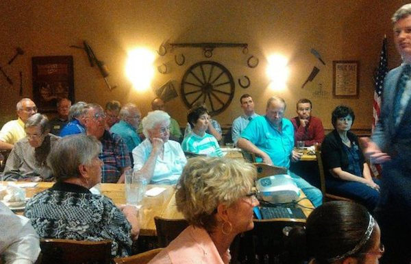 How many members of this all-white, mostly Christian audience believe the End Times are coming and thus, by Ravnsborg's reasoning, are hard to reason with? Brown County GOP lunch, Aberdeen, South Dakota, 2015.07.09.