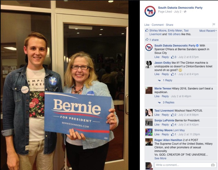 "SDDP chair Ann Tornberg holds a ""Bernie for President"" sign—Ann! You know they're talking Sanders, not Hunhoff, right? (SDDP Facebook page, Sioux City, IA, 2015.07.02)"