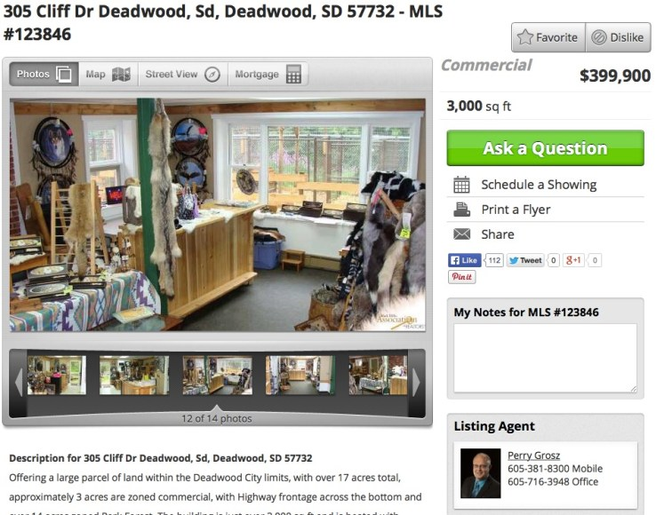Pet a wolf, buy a pelt—screen cap from real estate listing for site of Fur-Ever Wild wolf-petting exhibit in Deadwood, SD, downloaded 2015.07.25.