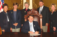 Standing around for pictures to make Mike look good—Governor Rounds signs executive order creating Interagency Council on Homelessness, 2003.09.25. Photo from HUD.
