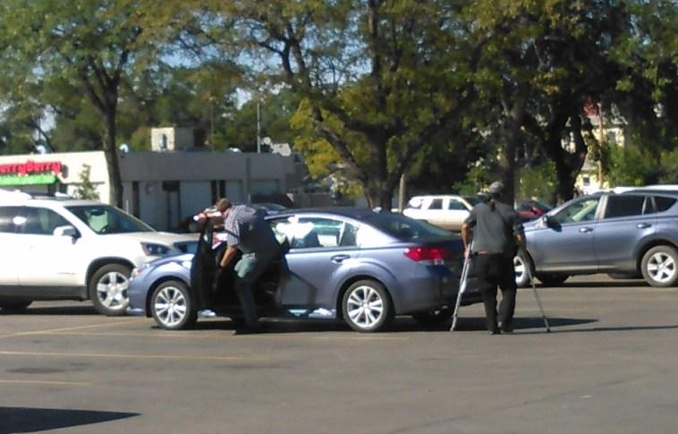 Handler and circulator get in their car at Kesslers.