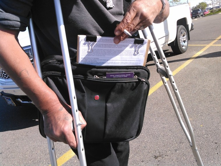 Circulator's bag, with petition on clipboard and purple Marsy's Law flyer.