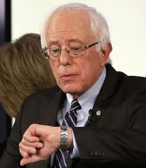 Bernie Sanders checks his watch