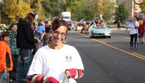 Samantha, making sure every paradegoer gets Smarties and a smile.