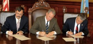 Lt. Gov. Matt Michels, Gov. Dennis Daugaard, and Attorney General Marty Jackley cast South Dakota's three Electoral College votes for Mitt Romney in 2012. Photo by Kelsey Webb, SD Governor's Office, 2012.12.18.