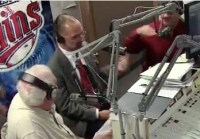Al Novstrup makes a strange throat-slashing gesture as I explain why a boycott is a reasonable moral response to legislators' attempt to discriminate against customers based on religious beliefs. Screen cap from KSDN podcast, 2016.11.04.
