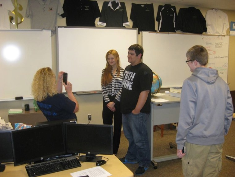 Butina in Sioux Falls classroom; FB photo dated 2013.05.13.