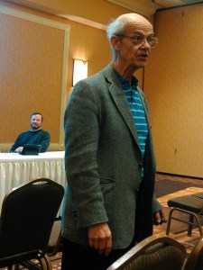 Dr. Harwood Schaffer, Agricultural Policy Analysis Center, addresses a couple-three dozen ag producers at the Dakota Event Center, Aberdeen, South Dakota, while event host and South Dakota Farmers Union president Doug Sombke (background) looks on. Photo by CAH, 2017.03.20.