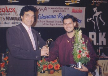Dale Bhagwagar receives the Zigma Award For Excellence from actor-producer Dheeraj Kumar.