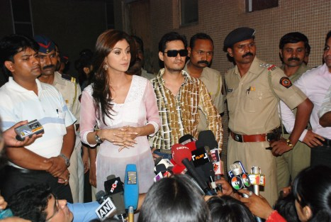 Dale Bhagwagar stands in support as he facilitates media interviews of Shilpa Shetty on the Richard Gere controversy.