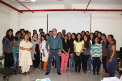 Dale Bhagwagar with students of journalism and PR.