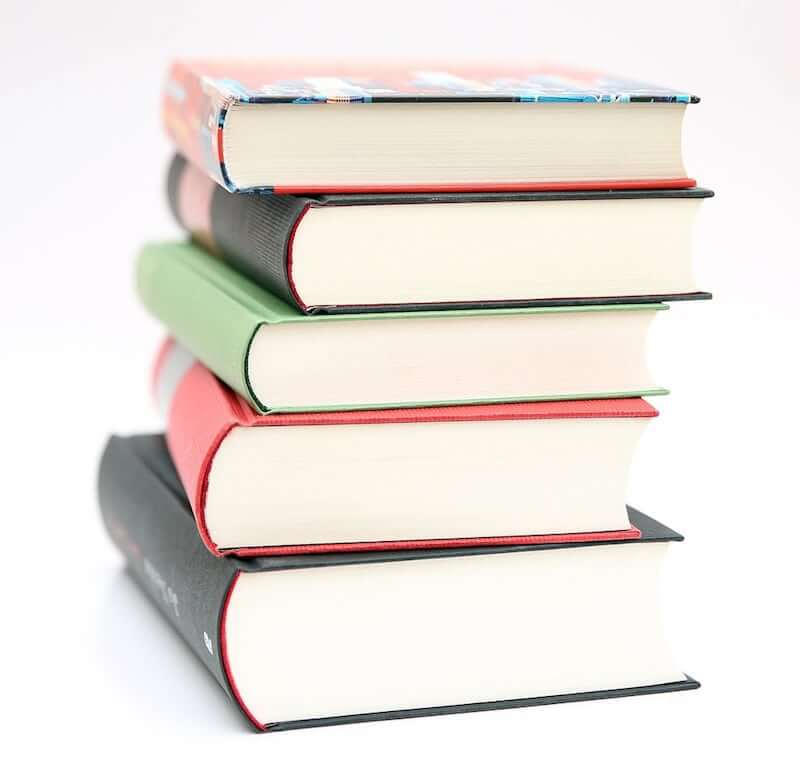 Image of book pile to illustrate tracking book sales