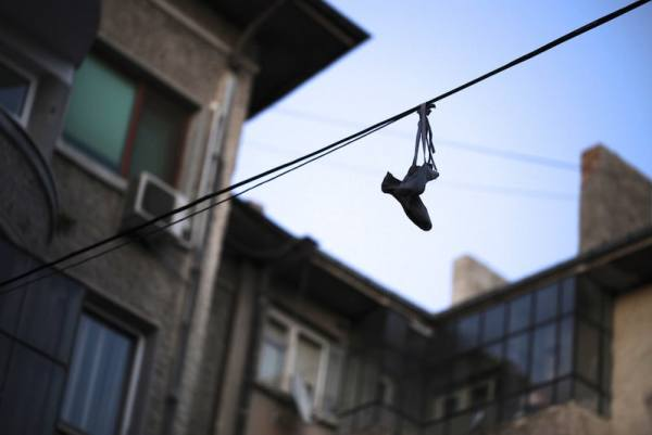 Shoes dangling from an electrical line