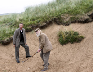 """""""Old Tom Morris"""" hits out of bunker with a hickory club"""