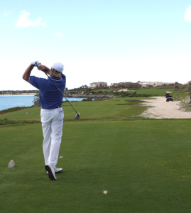 Greg Norman hitting at Emerald Bay GC on Great Exuma. Copyright Donnelle Oxley