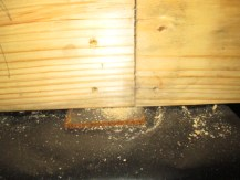 On this new construction home inspection the beam splice was not properly shimmed. Another issue which passed the code inspection but found on the final home inspection.
