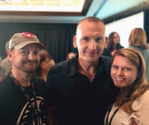 Being a great sport, Chris Eccleston poses with Paul, but mostly with Caroline.