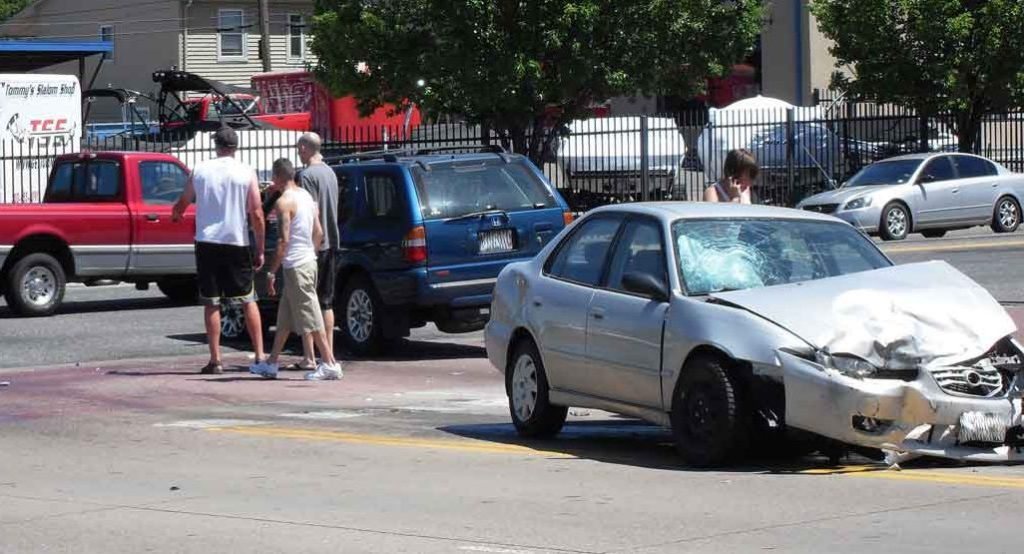 White vehicle damaged in accident, negligent entrustment accident attorney