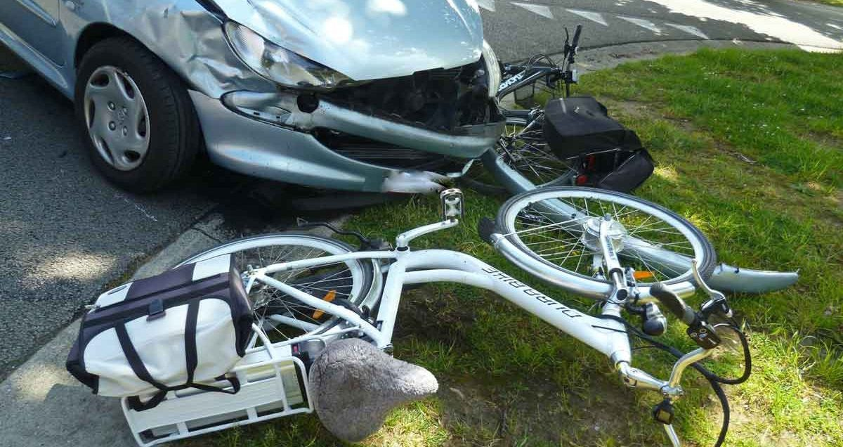 Car with damage to front in and two damaged bicycles hit in collision, Plano bicycle accident attorney