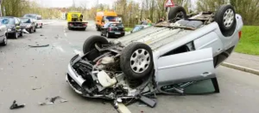 Vehicle upside down on highway, arm injury accident lawyer