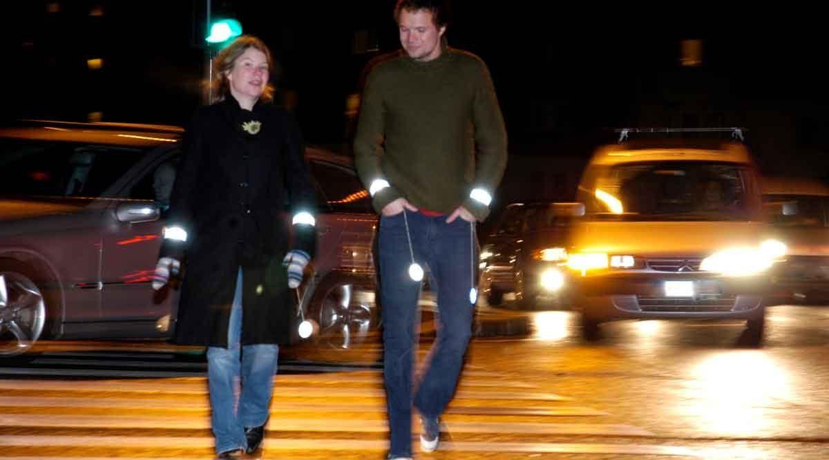 Pedestrians crossing at crosswalk at night, Plano pedestrian accident attorney