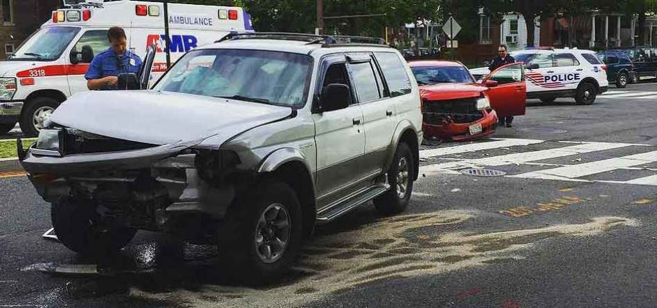 Wrecked SUV at intersection. Dallas intersection accident lawyer.