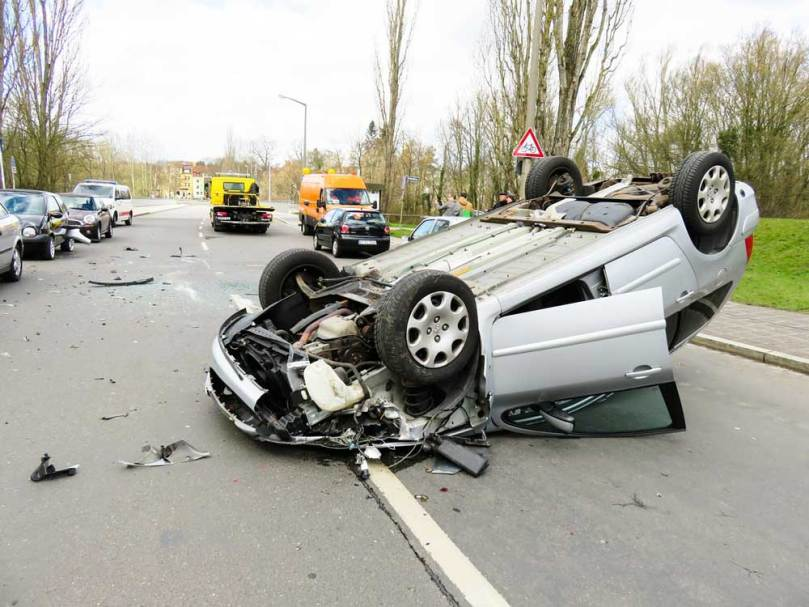 Car overturned after an accident. Dallas internal organ injury lawyer