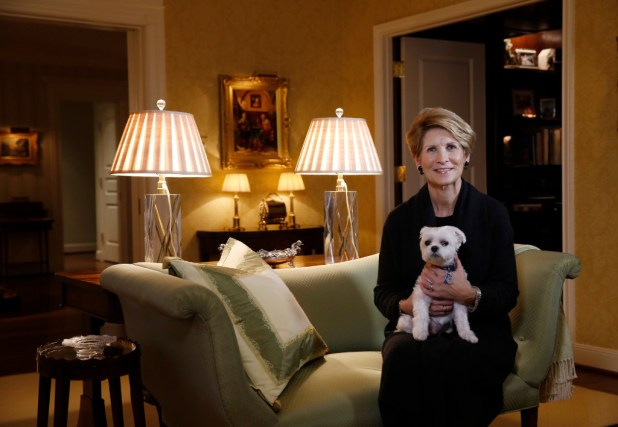 Laura Miller, former Dallas mayor, in her living room with the family dog, Willie.  (David Woo/The Dallas Morning News)