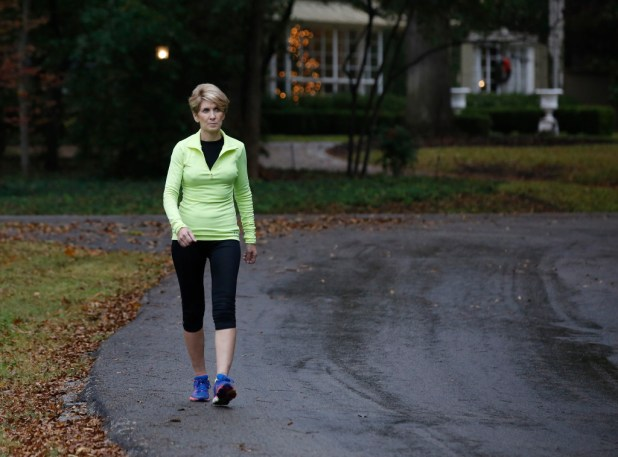 Laura Miller takes a brisk walk in her neighborhood three weeks after her surgery. She has been a regular runner since 1977 and is looking forward to her first run after surgery. (David Woo/The Dallas Morning News)