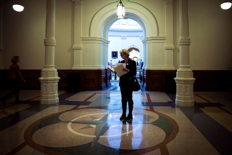 Christy Zartler  consults her notes for her next meeting while shuffling between meetings at the Texas state capitol on March 15, 2017, in Austin. (Smiley N. Pool/The Dallas Morning News)