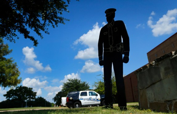 A wooden silhouette of a police officer stands in front of the Balch Springs Police and Fire Complex Monday in Balch Springs. Roy Oliver, the fired Balch Springs police officer who shot and killed 15-year-old Jordan Edwards, was indicted Monday on a murder charge by a Dallas County grand jury(Tom Fox/Staff Photographer)
