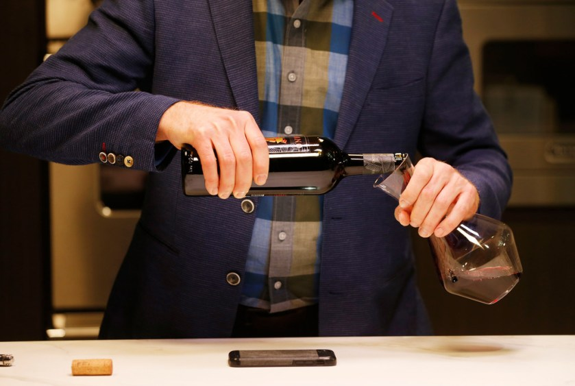 James Tidwell demonstrates how to pour when decanting wine.(Vernon Bryant/Staff Photographer)