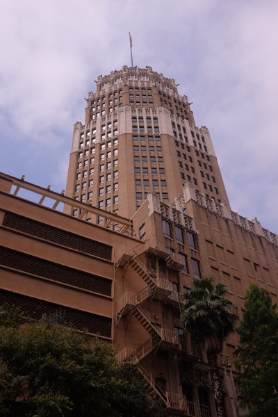 The Tower Life Building. At the top of the buildings are gargoyles built in the 1920s style of architecture.