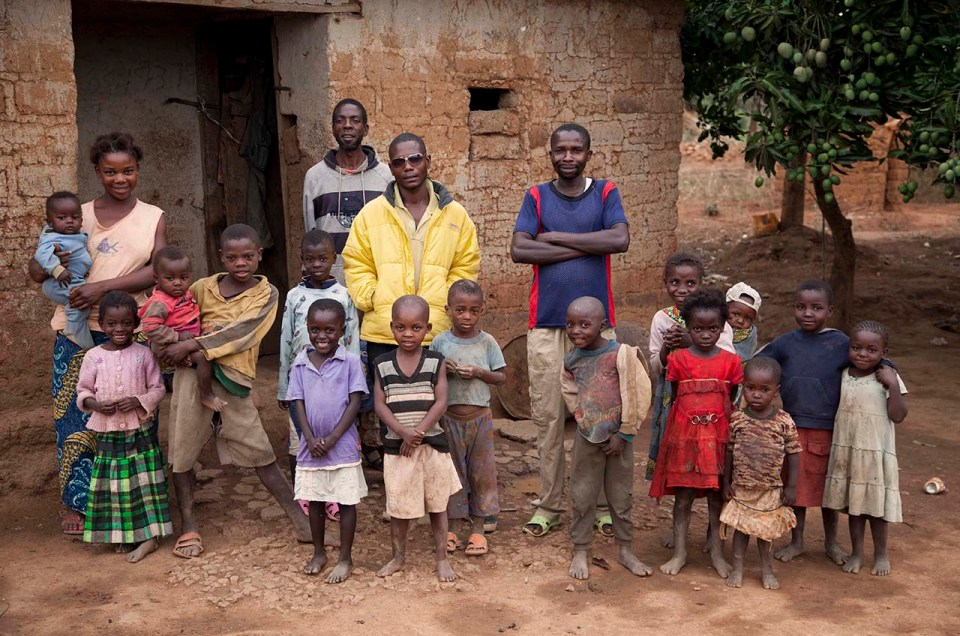 In the DRC Children and adults pose for a picture.