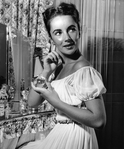 Elizabeth Taylor puts on perfume and is sexier than everyone.