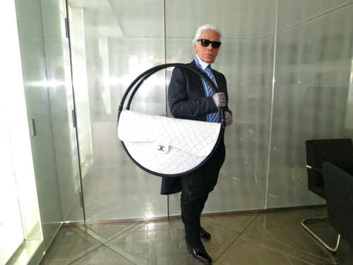karl with giant chanel hoop bag