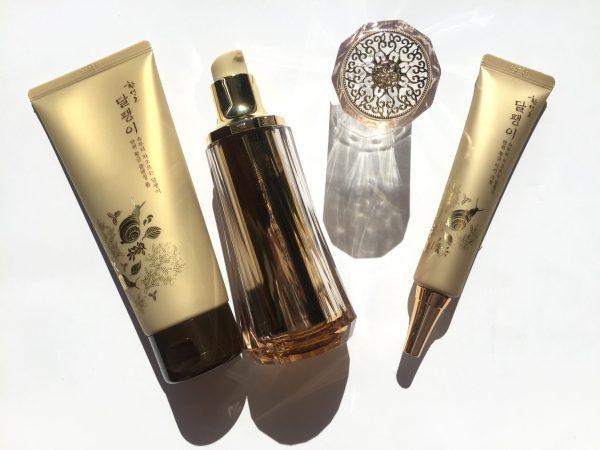 from left: Hwansaenggo Escargot Golden Cleansing Foam, Golden Firming Fluid & Golden Firming Eye Cream