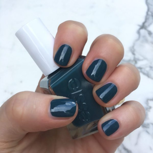"Essie Gel Couture ""off duty style"" is a rich yet somewhat dusty teal. LOVE. The sun was hiding when I took this pic."