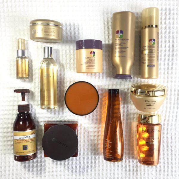 clockwise from top right: Pureology Nano Works Gold & Precious Oils, Kerastate Elixir Ultime, Shu Uemura Urban Moisture, Saryna Key Shea Butter, Wella Luxe Oil