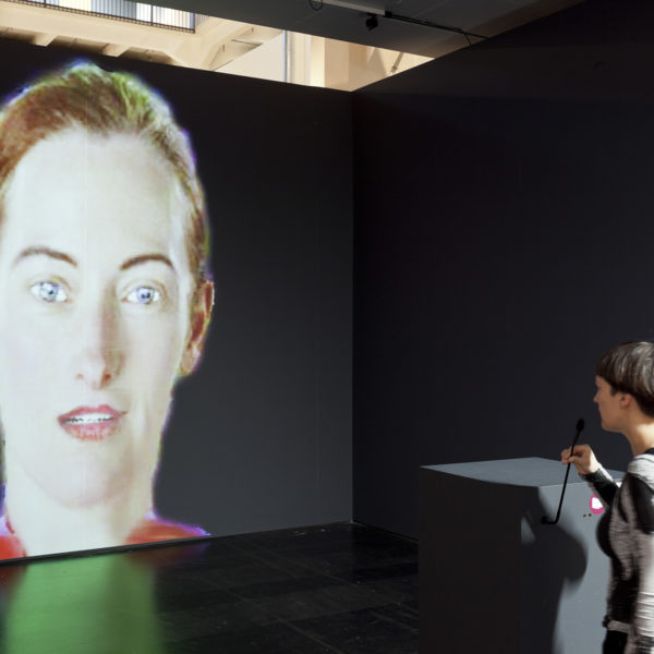 Lynn Hershman Leeson, DiNA, Artificial Intelligent Agent Installation. Interactive network-based multimedia installation (custom software, sound, voice recognition, voice synthesis, sensors, one way mirror; alternative presentation with projection), 64 x 60 x 17 cm (dimensions of installation variable). 2004.