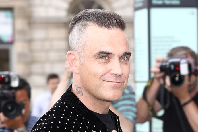 Robbie Williams' Secret to Surviving Confinement Without Divorcing