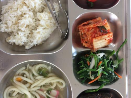 A typical school lunch: kimchi & rice, plus a protein, soup, side dish and dessert (cherry tomatoes).